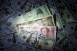 Picture of Investors trim long positions on Asian currencies, yuan bets halved