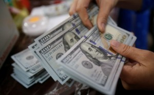 Picture of Dollar Up, Boosted by Plunge in Chinese Shares and Caution Ahead of Fed Decision