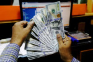 Picture of Dollar at lowest in a month after Fed knock; U.S. data disappoints