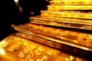 """Ảnh của Vàng nhảy vọt hơn 1% trước quan điểm """"ôn hòa"""" của Fed"""