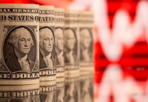 Picture of Dollar touches three-week high, lifted by recent data, Fed taper view