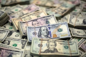 Picture of Dollar hovers near one-week low as Evergrande questions persist